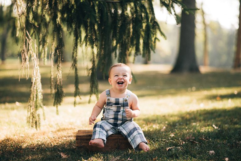 Smiling baby on box under a tree in Hinsdale, IL