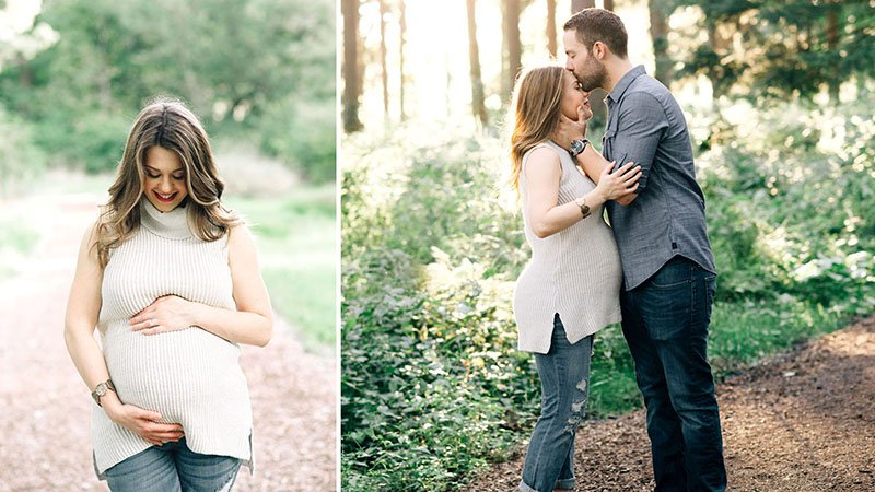 Pregnant wife holds her belly, as her husband kisses her forehead