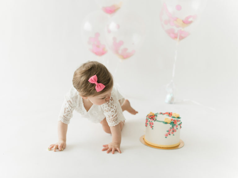 Child with balloons and cake studio photo session