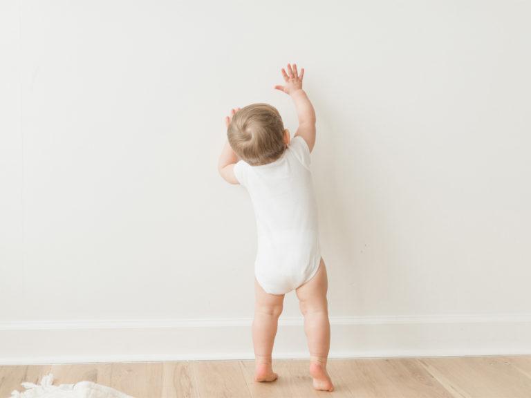 Boy in white onesie photo session