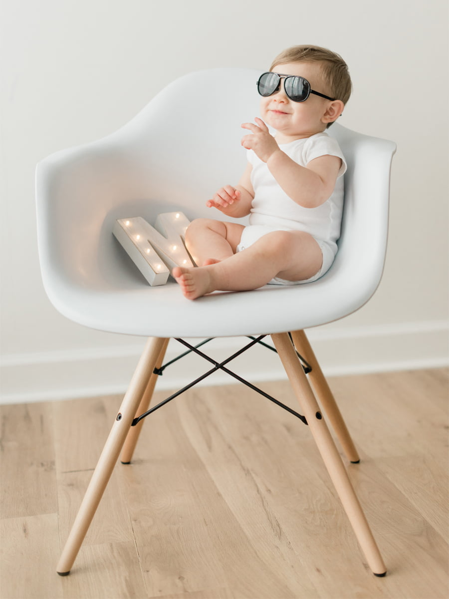 Glasses onesie chair and a light prop photo shoot
