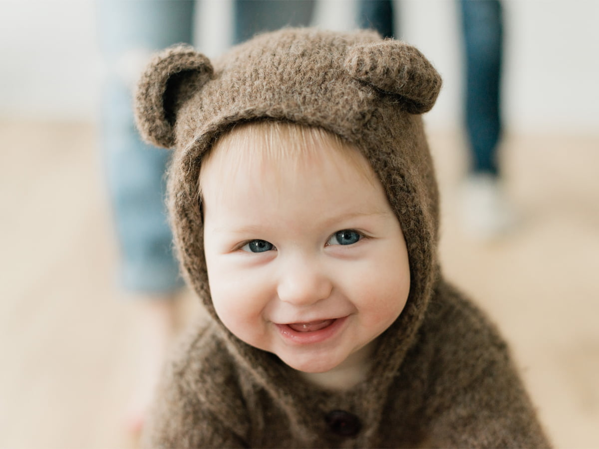 Boy dressed as bear studio photo session